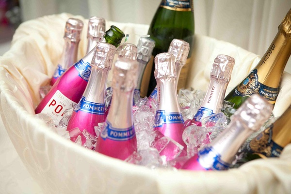 Bottles of Pommery Champagne on ice at wedding cocktail party
