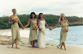 bride and bridesmaids in green dresses