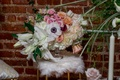 anemone, white lily, peach roses, pink flowers, small white faux fur