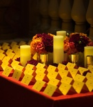 White pillar candles and seating cards on table