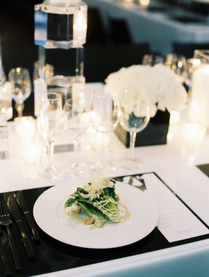 plated salad at chic black and white tablescape