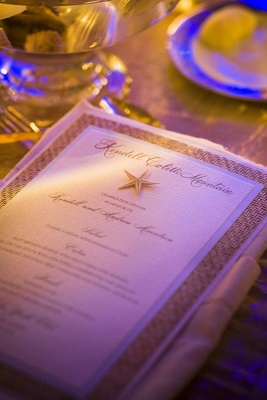 Destination wedding textured menu with real starfish