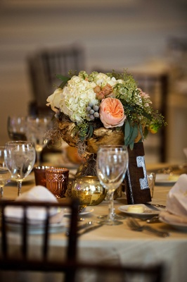 Gold rustic wedding centerpiece with white hydrangea, pink rose, and greenery letter block letter