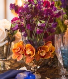 wedding styled shoot, fuchsia sweet peas, orange orchids