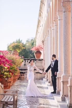 bride in pronovias wedding dress with lace bodice, crepe skirt, groom in tuxedo, ca' d'van wedding