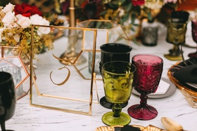 Wedding reception marble table colorful goblet glassware gold rim glass table number calligraphy