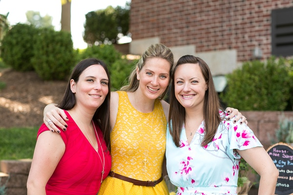 Bride to Be with friends in bright dresses at wedding shower