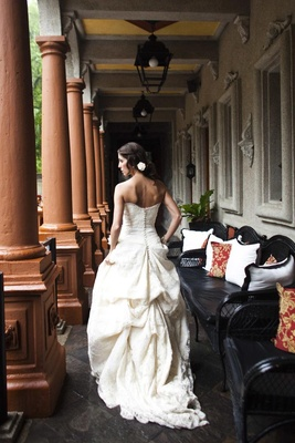 Button-back wedding dress with bustle details