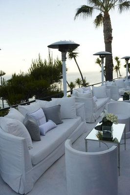 Lounge area at reception with ocean views and white furniture