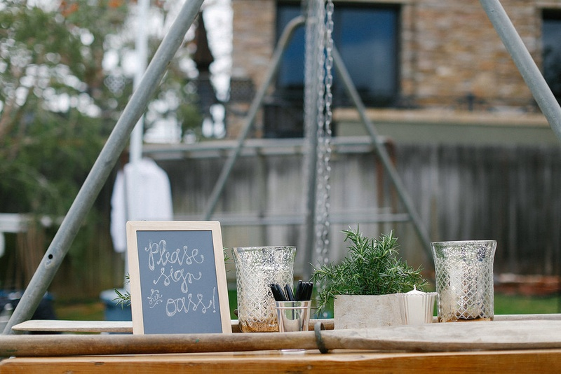... Chalkboard sign at guest book table with wooden oars to sign · Tent ... & Tent Wedding with Chic Nautical Theme in San Diego - Inside Weddings
