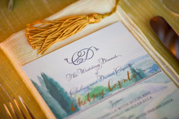 Wedding reception menu with a watercolor rendering of the Tuscan countryside