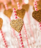 Wedding shower with pink and ivory chevron straws, glitter hearts in Champagne flutes