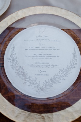 gold charger plate round menu card laurel wreath design three course meal