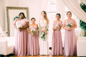 bridesmaids in mismatched dusty rose morilee dresses, bride in pronovias wedding dress with lace top