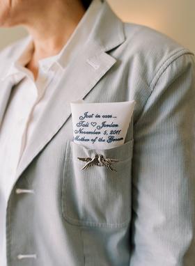 Dove pin and hanky tucked into jacket pocket