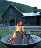 Firepit outside cabin at rustic wedding reception