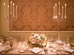 wedding reception damask wallpaper crystal candelabra low centerpiece pink white flowers gold