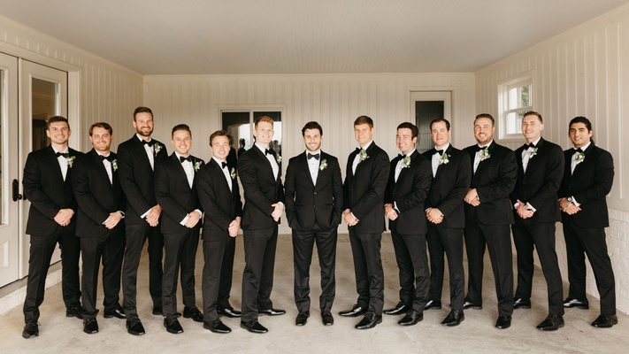 wedding party groom and groomsmen in tuxedos suits bow ties boutonnieres arkansas wedding in garage