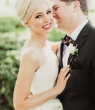 Classic bridal gown illusion neckline sleeveless updo groom in suit and black bow tie lapel