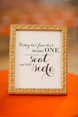 ceremony sign telling guests to seat on either side