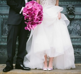 Groom and bride with phalaenopsis orchid bouquet and hand painted wedding shoes