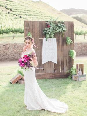 bride boho vibe beaded gown california boho chic wedding styled shoot bright bouquet malibu flower