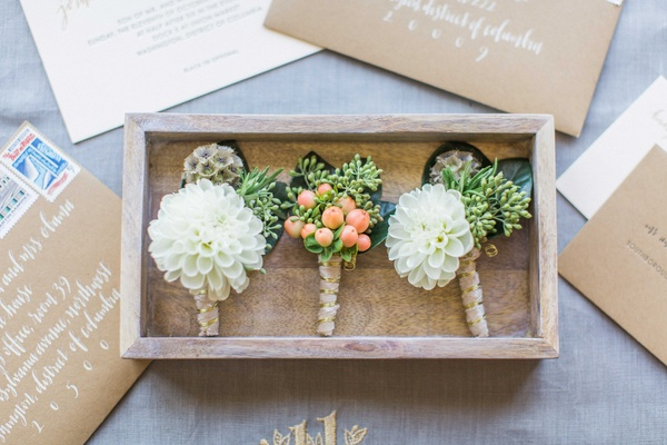 Rustic wedding boutonniere ideas white dahlia scabiosa pods and greenery with berries