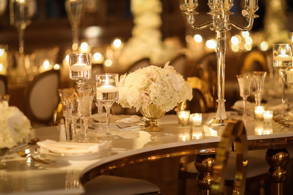 wedding reception at the mar a lago club white rose centerpiece floating candle and candelabra