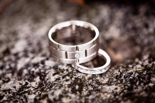 Groom and bride wedding rings with diamonds on rock