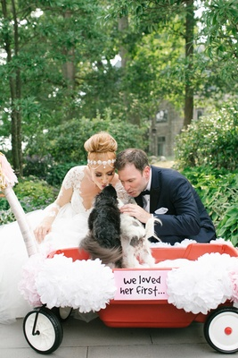 bride in hayley paige, headpiece, groom in ike behar, puppies in wagon
