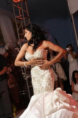 Bride performs the traditional wedding hula at reception