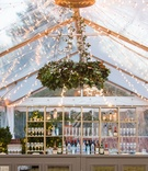 tent wedding, string lights, greenery chandelier, bar