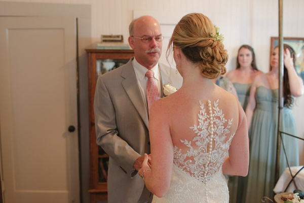 father of the bride gets emotional in bridal suite at destination wedding in Hawaii