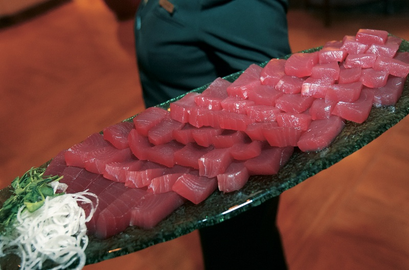 Marble plate of raw tuna with garnishes