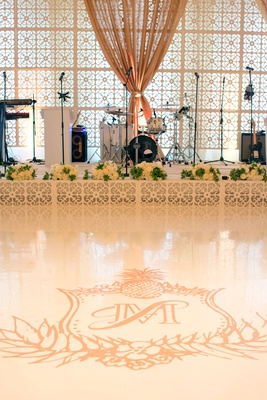 Wedding reception live band stage white dance floor with tropical monogram custom ceci new york