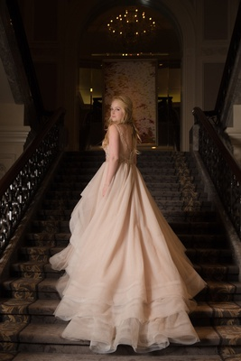 bride on staircase in chicago wedding venue Martina Liana wedding dress blush ivory champagne layers