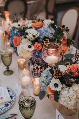 wedding reception centerpiece blue and white vase anemone hydrangea rose blue pink green