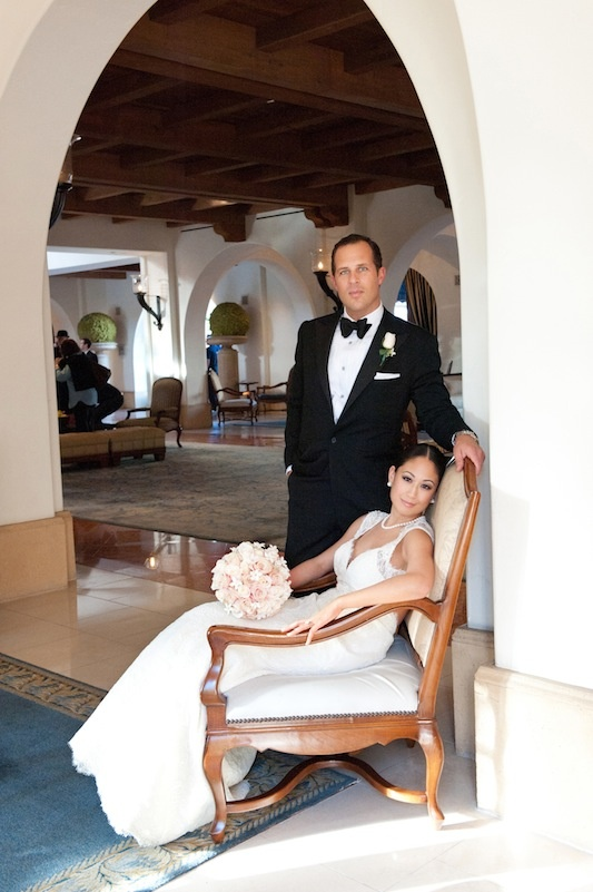 Bride on throne in hotel with tuxedo groom