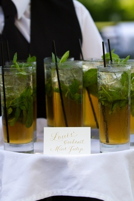 Groom's signature wedding drink with mint garnish