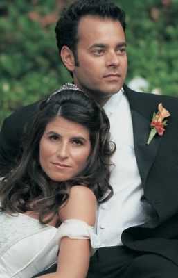 close up newlyweds with orange boutonnier