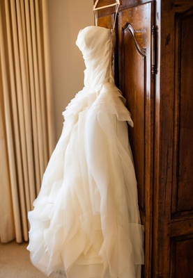Strapless Vera Wang bridal gown on hanger