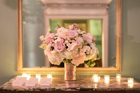 wedding reception small arrangement of ivory hydrangea pink rose white pink flowers candles cards
