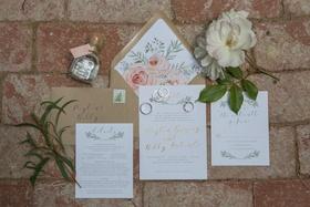 Kraft paper envelope with calligraphy laurel wreath motif and pink flower envelope liner rustic