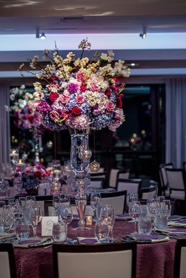 wedding reception centerpiece on crystal vase, blue and white hydrangeas, red and pink roses, crysta