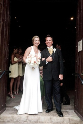 Bride and groom at Episcopal church entrance in