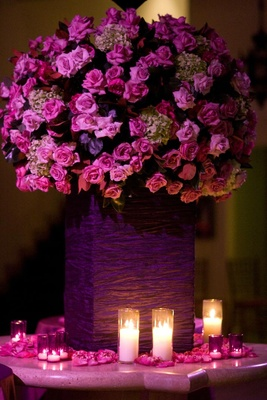 Fuchsia flowers surrounded by petals and candles