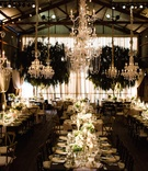 Tin barn wedding with crystal chandeliers and drapery