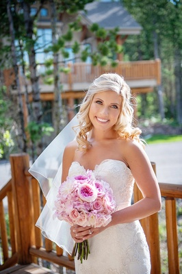 Wedding hairstyle for blonde bride with side part and curls