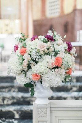 Wedding ceremony flower arrangement white urn with white hydrangea peach rose purple flower dahlia