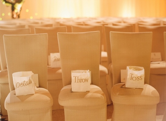 White paper bag with gold lettering on chairs